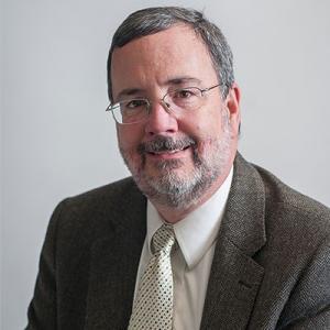 Portrait of Dan Carlin sitting